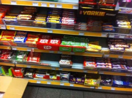 Shop shelves after Nestle red tray have been fitted