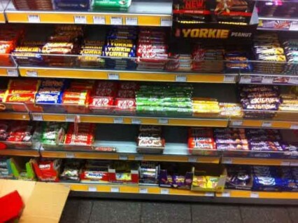 Shop shelves before Nestle red tray have been fitted