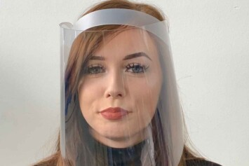 A face on view of a woman wearing full face visor