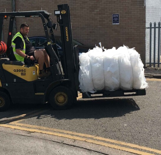 A forklift loading Polypropylene for return to the mill